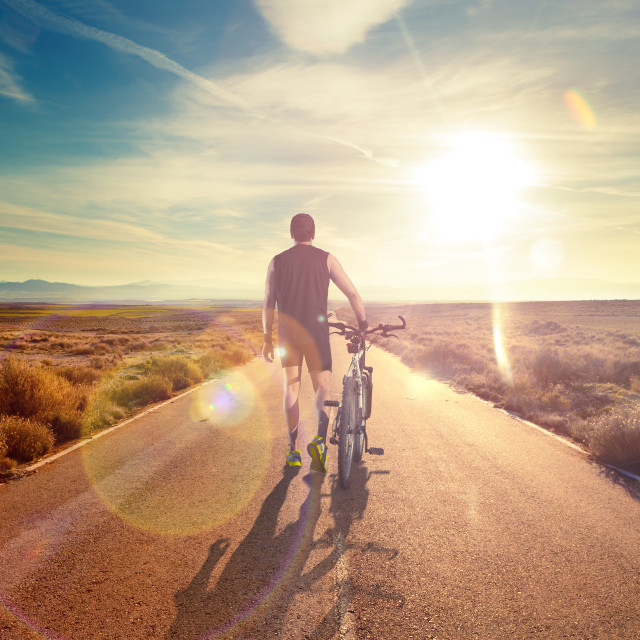 """Bicycle sport and sunset.Road through the landscape."" stock image"