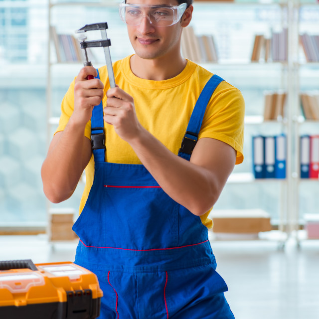 """Furniture carpenter working in the workshop"" stock image"