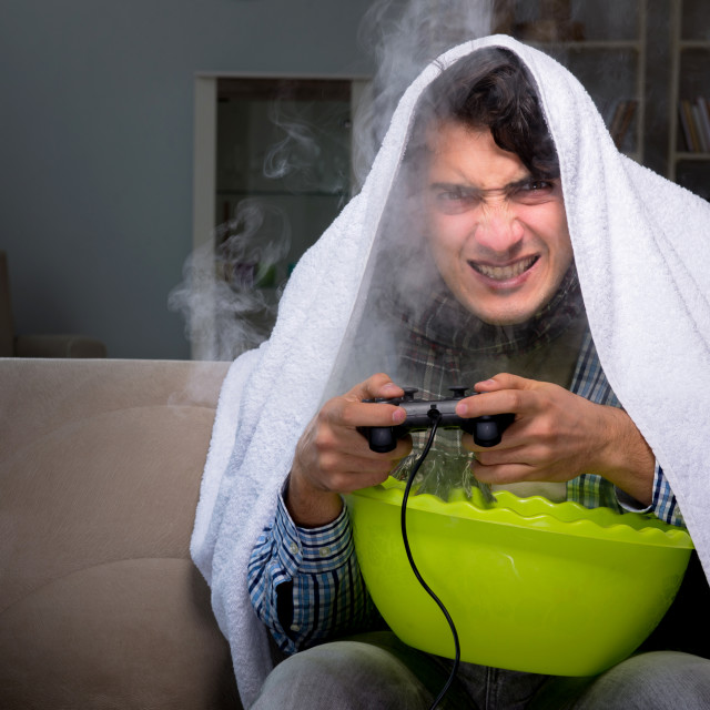 """""""Sick man doing inhalation at night in home"""" stock image"""