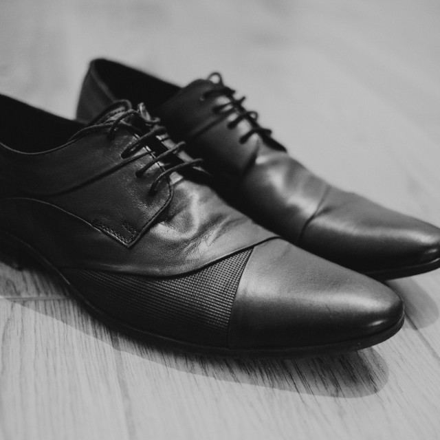 """""""close up on black leather boots on wood, black and white, retro and vintage"""" stock image"""
