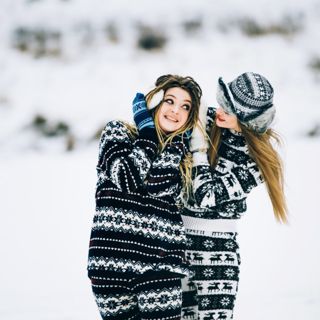 """Couple of young woman are wearing warm clothes in winter"" stock image"
