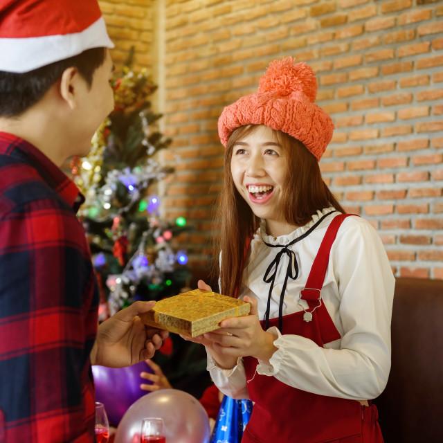 """girlfriend get Christmas gift from boyfriend"" stock image"