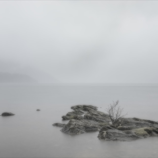 """Rocks in the rain at Loch Lomond"" stock image"