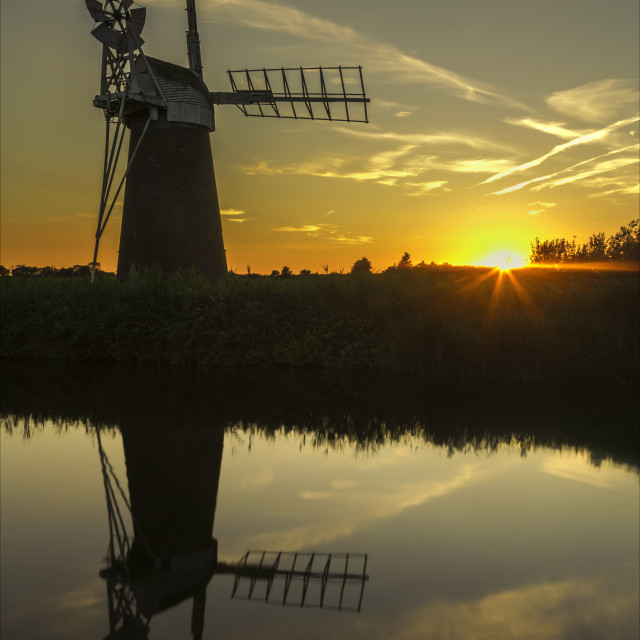 """Sunset at How Hill wind pump"" stock image"