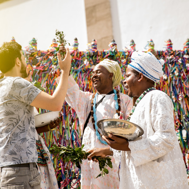 """""""Tourist with candomble group wearing traditional clothes at Bonfim Church in Salvador, Bahia, Brazil"""" stock image"""