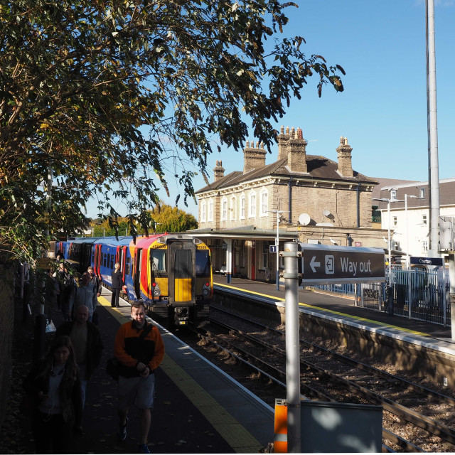 """Chertsey Station and class 458 train"" stock image"