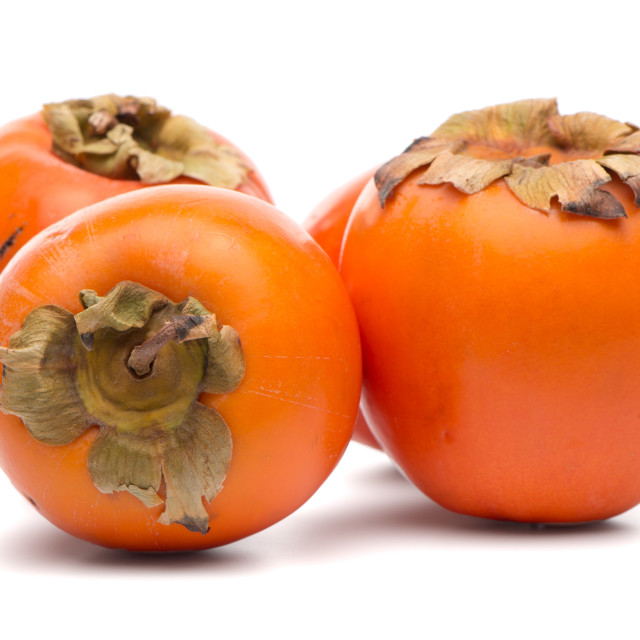 """Persimmon fruits on white"" stock image"