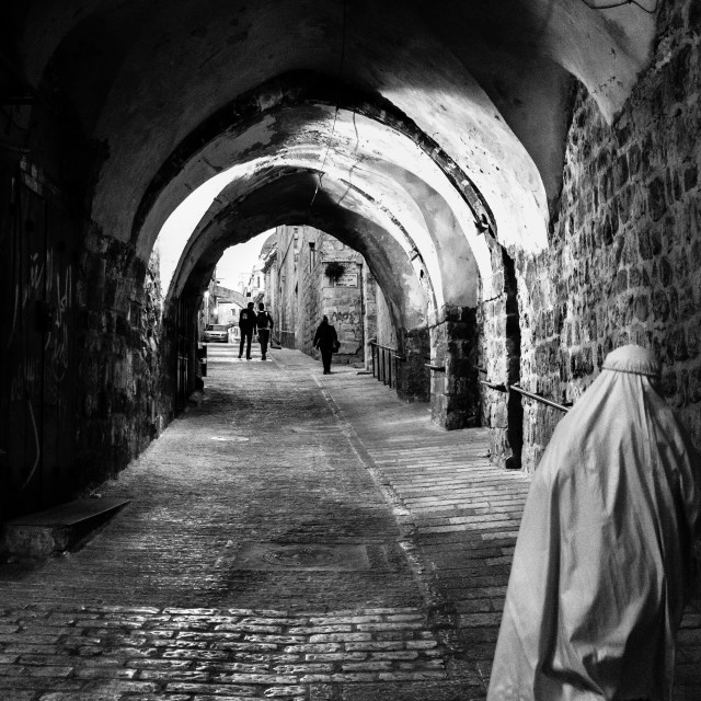 """Pilgrimage walking down the alley in Jerusalem old city"" stock image"