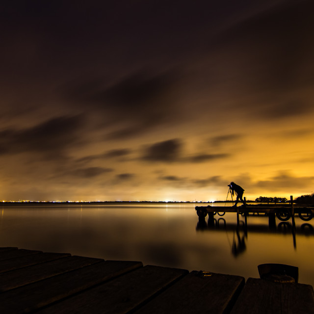 """Long exposure of female photographer at lake near Valencia"" stock image"