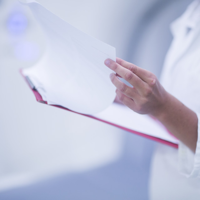 """Hospital radiologist checking notes"" stock image"