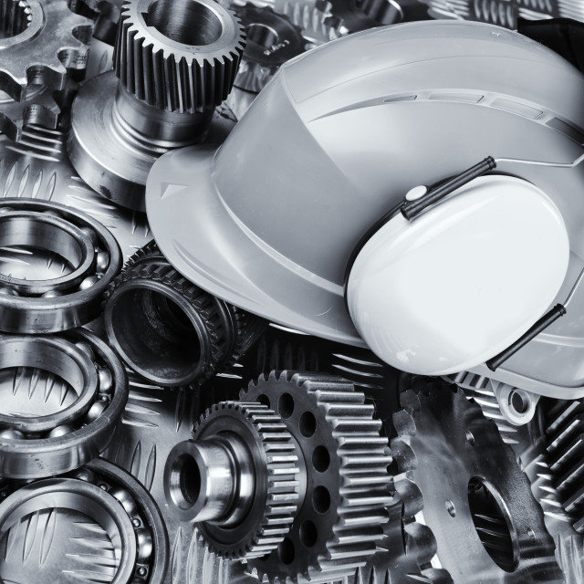 """Hardhat with industrial gear parts"" stock image"