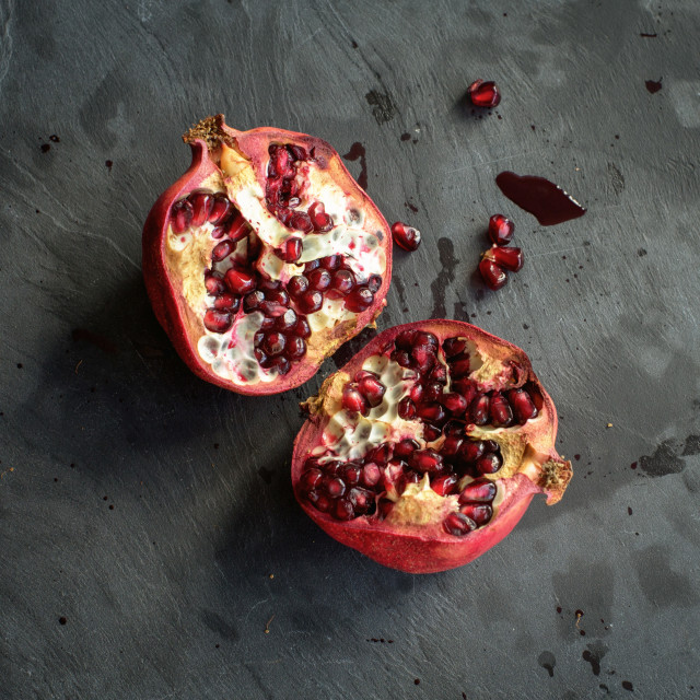 """Pomegranate on gray background"" stock image"