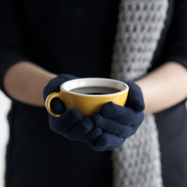 """Woman holding a cup of coffee"" stock image"