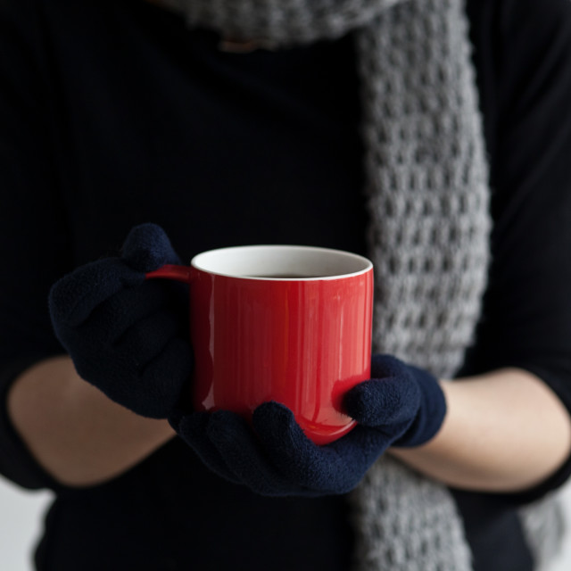 """Woman holding a mug of coffee"" stock image"