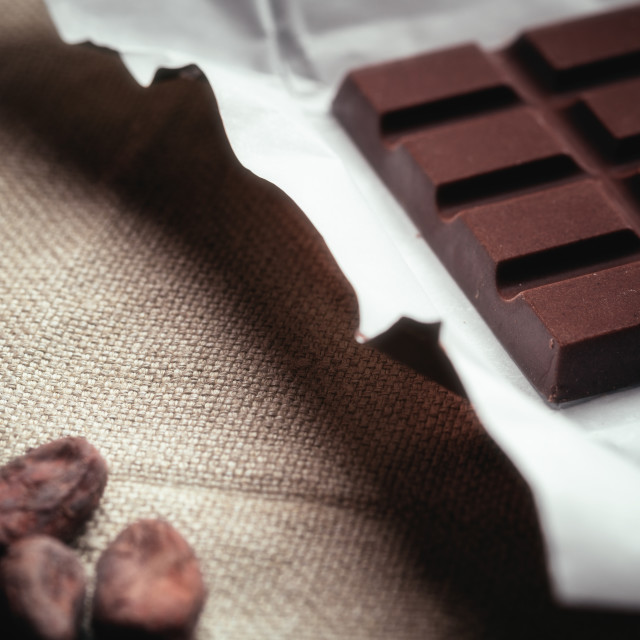 """""""Dark chocolate and Raw cocoa beans. Background texture of old ju"""" stock image"""