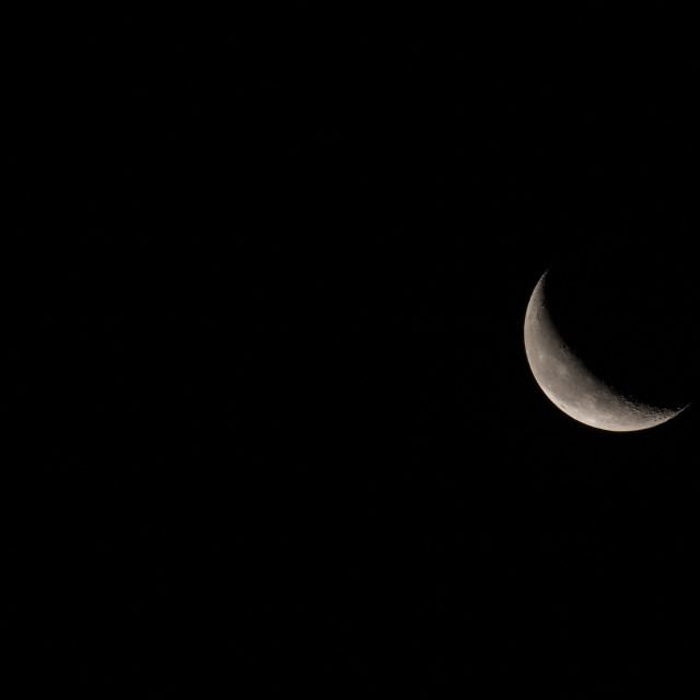 """""""Waning Crescent Moon with text Space to Left"""" stock image"""