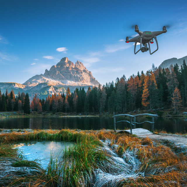 """Lago Antorno Lake, Italy - October 20 ,2017: Flying drone quadco"" stock image"