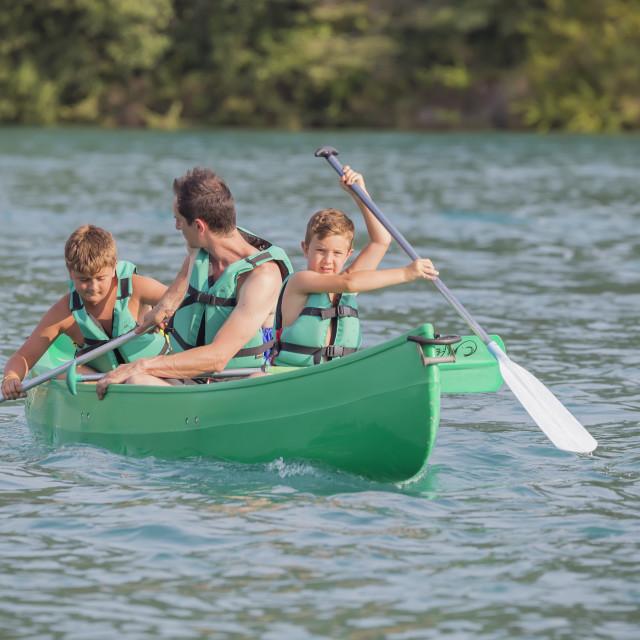 """Family practicing canoe, Esparron lake, Esparron de Verdon, Alpes de Haute..."" stock image"