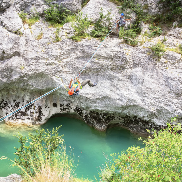 """""""Man crossing the Verdon river on a rope, Provence-Alpes-Cote d'Azur,..."""" stock image"""