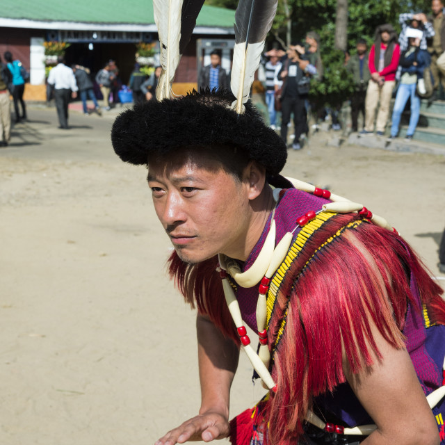 """""""Naga tribal man in traditional outfit playing drum, Kisima Nagaland Hornbill..."""" stock image"""