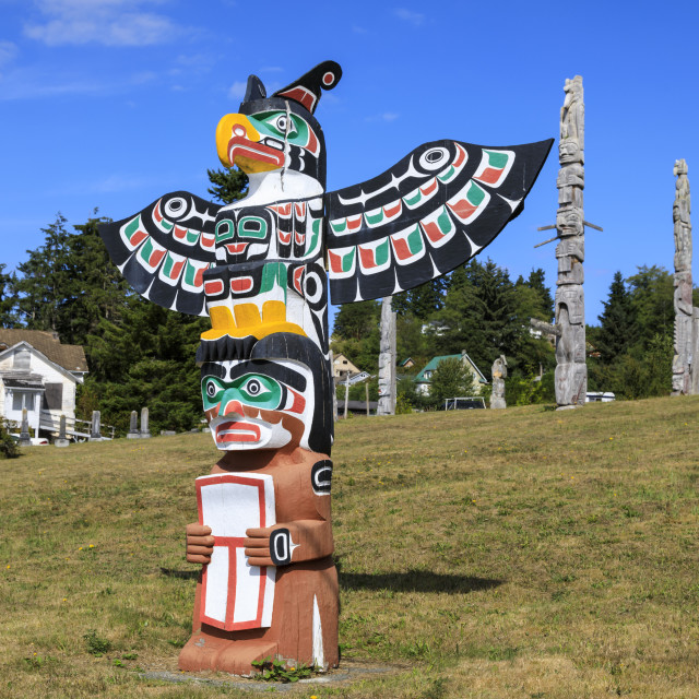 """First Nation Totem Poles, Original Namgis Burial Grounds, Alert Bay,..."" stock image"