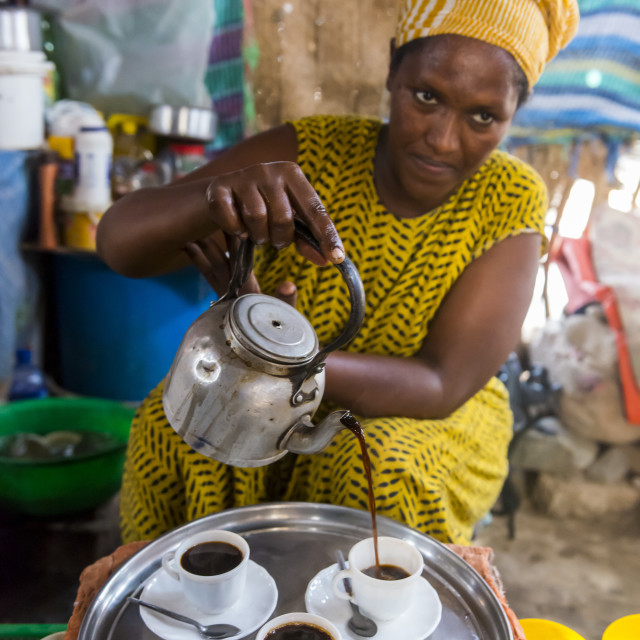 """Woman serving ethiopian coffee, Danakil depression, Ethiopia"" stock image"