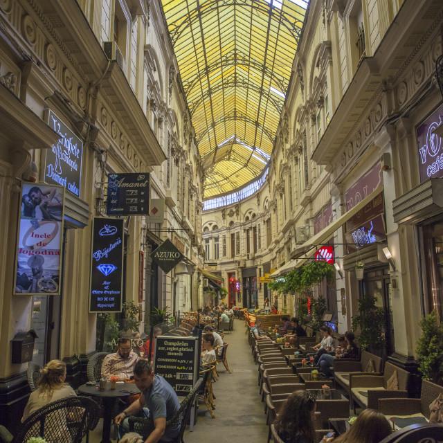 """Old quarter street scene_Covered cafe pedestrian street"" stock image"