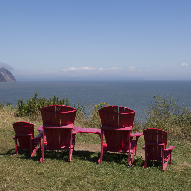 """Parks Canada's red chairs at Fundy National Park, overlooking the Bay of..."" stock image"