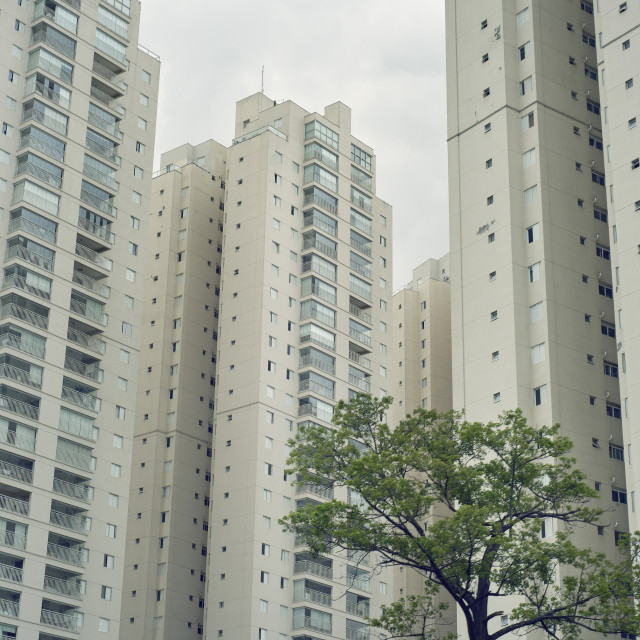 """Imposing residential developments over shadow their surroundings and a stark..."" stock image"