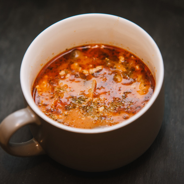 """""""Pizza soup with meat, mushrooms, cheese, tomato and herbs"""" stock image"""