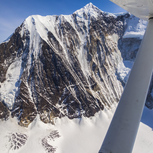 """Aerial view of the steep NW face of Mt. Hayes, the tallest mountain in the..."" stock image"