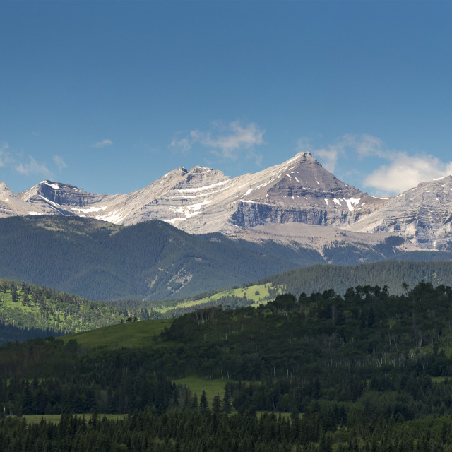 """Panorama of foothills and the Canadian Rockies mountain range with blue sky..."" stock image"