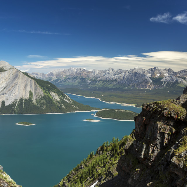 """View from the top of mountain ridge looking down on colourful alpine lake and..."" stock image"