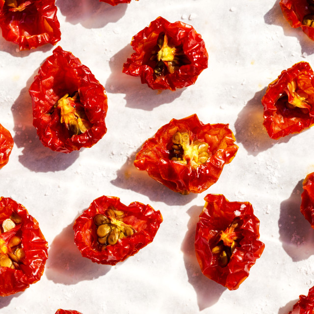 """Close-up of halved sun dried cherry tomatoes"" stock image"