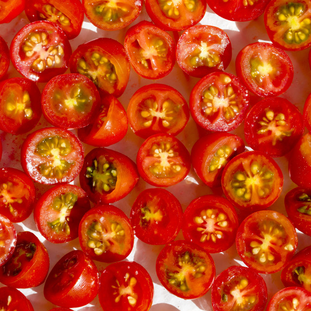 """Close-up of halved cherry tomatoes"" stock image"