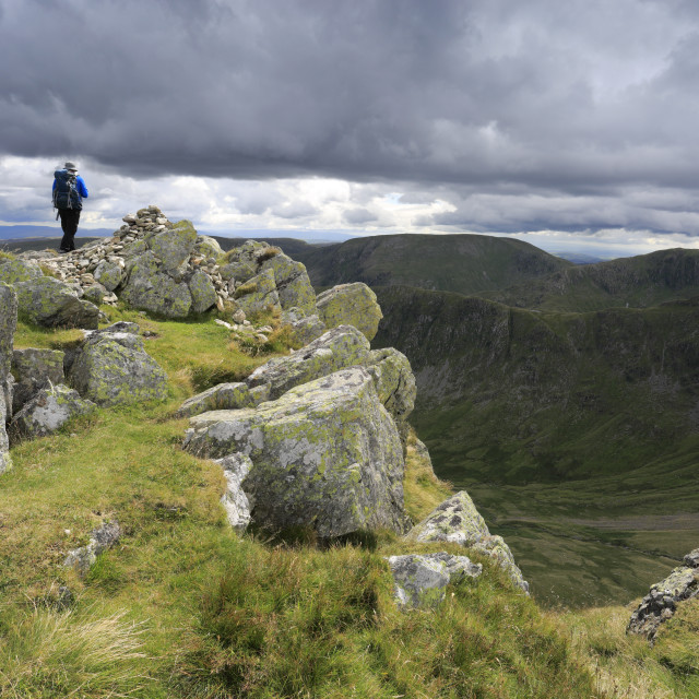 """""""Walker at the Summit cairn of Kidsty Pike fell, Lake District National Park,..."""" stock image"""