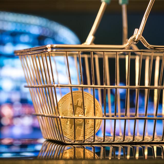 """Bitcoin coin in shopping basket"" stock image"