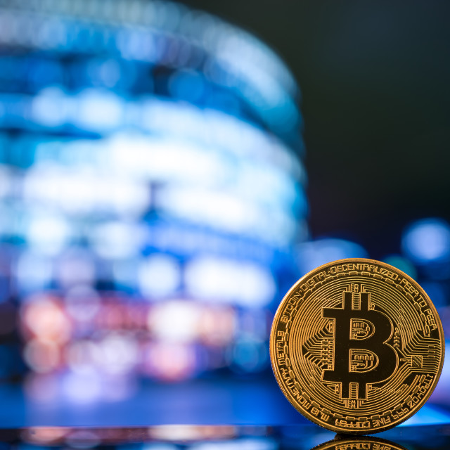 """Bitcoin against moder business centre blurred"" stock image"