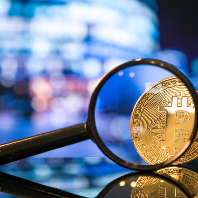 """Bitcoin under the magnifier, investment risk concept"" stock image"