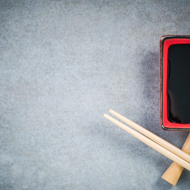 """""""Chopsticks and soy sauce on stone concrete board"""" stock image"""