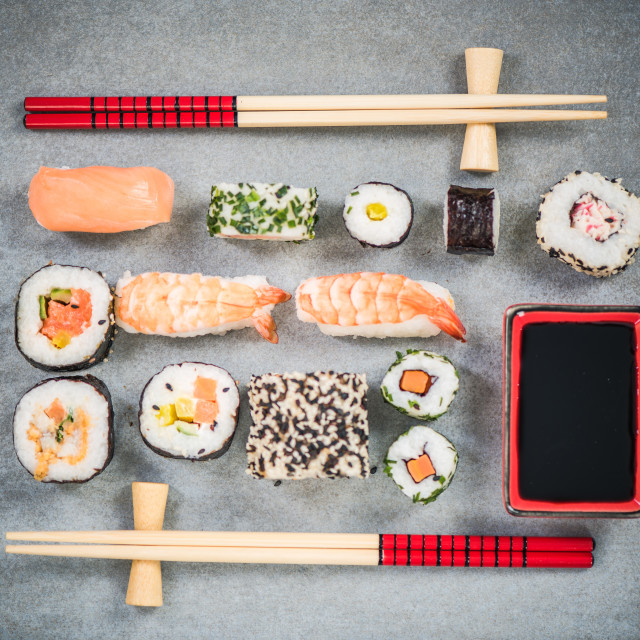 """Sushi on stone or concrete slate with chopsticks"" stock image"