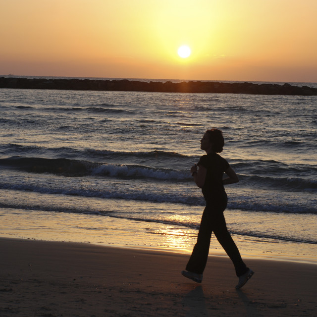 """Israel, Tel Aviv, running on the beach"" stock image"