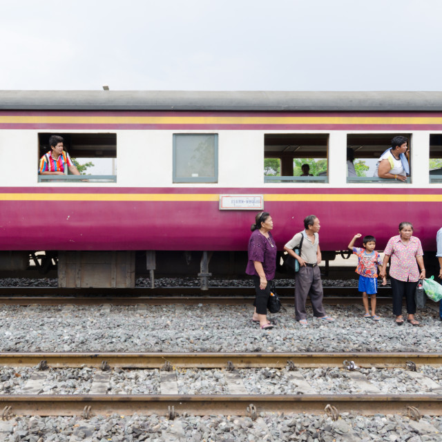 """AYUTHAYA, THAILAND - 28 APR 2014: Stranded passengers wait for the next train..."" stock image"