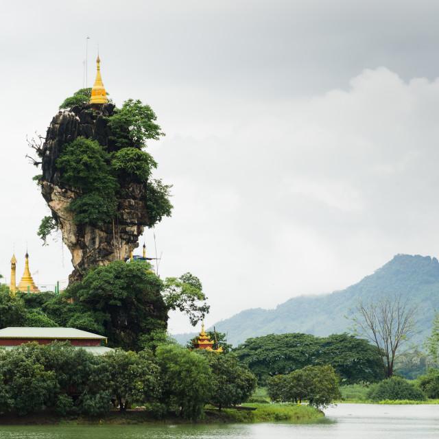 """Kyaut Ka Latt Pagoda perched atop a rock cliff in a lake, Hpa An, Myanmar."" stock image"