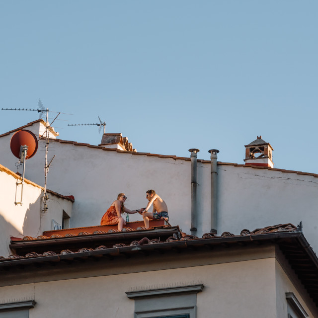"""Unidentified couple dinning in a roof in Florence"" stock image"