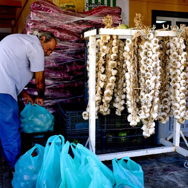 """Argostoli market garlic seller"" stock image"