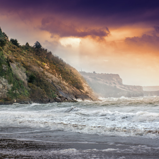 """Dramatic British coast with rough sea."" stock image"