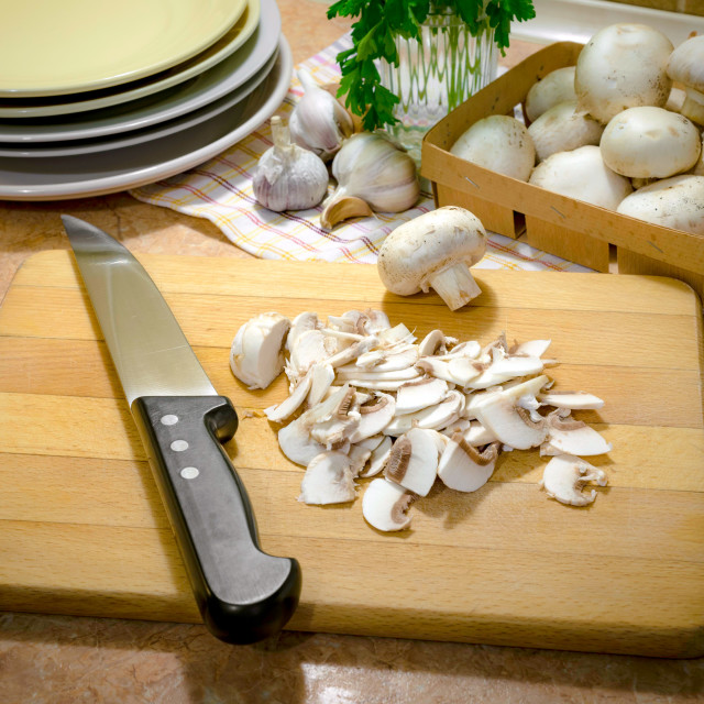 """Thinly sliced Champignons and cooked with oil, garlic and parsle"" stock image"