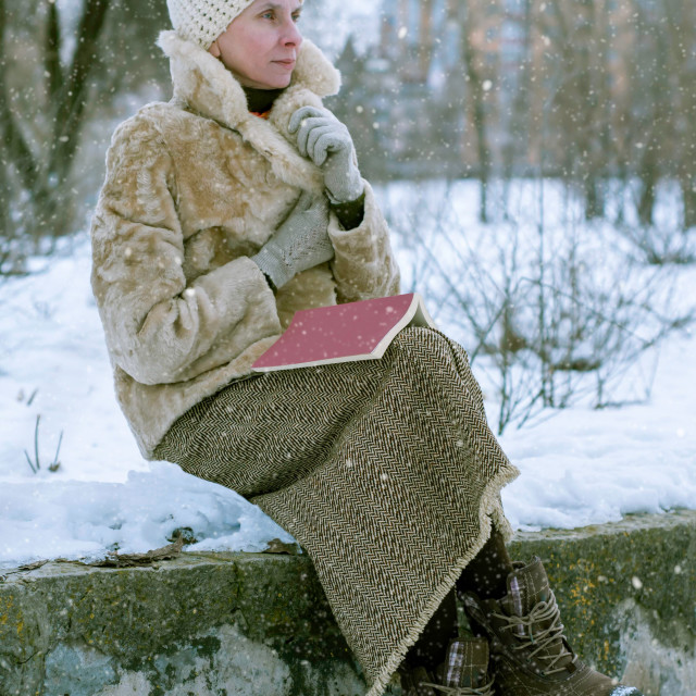 """Woman ready a book in winter"" stock image"