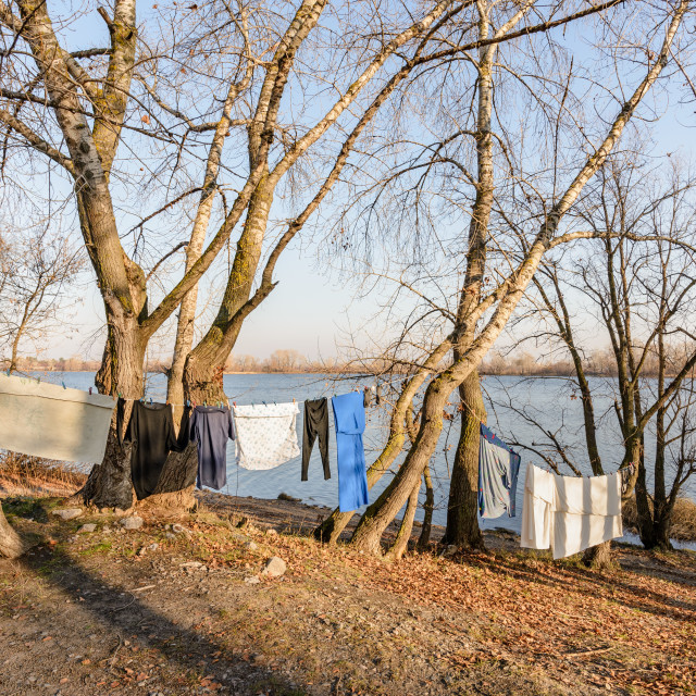 """Laundry drying on a wire, under the mild winter sun, near the ri"" stock image"